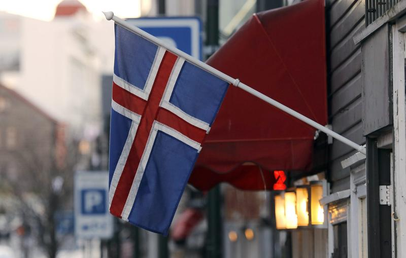 In this Thursday, Oct. 27, 2016 file photo, an Icelandic flag hangs outside a shop in Reykjavik. (Frank Augstein/AP)