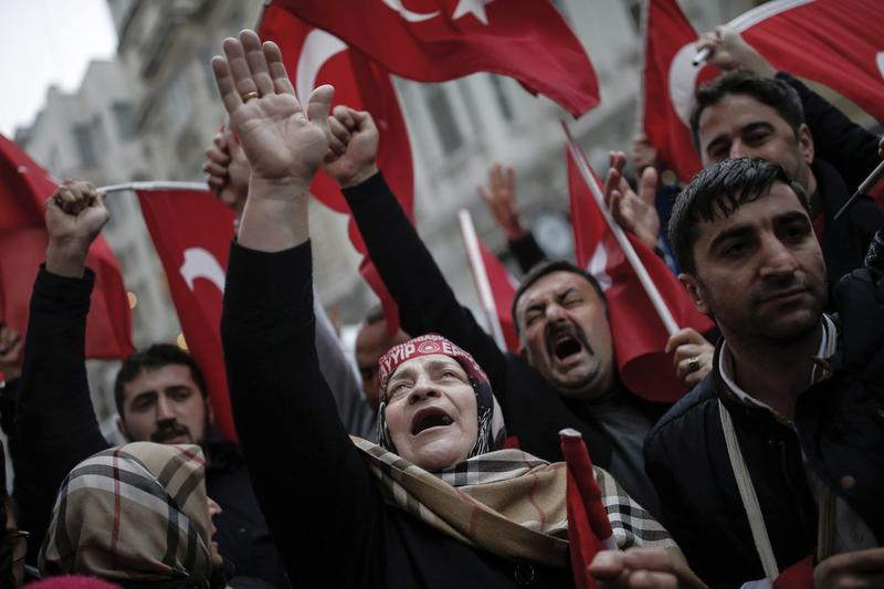 "A group of Turks protest outside the Dutch consulate in Istanbul, Sunday, March 12, 2017. Turkish President Recep Tayyip Erdogan says he appropriately accused the Dutch government of ""Nazism and fascism,"" saying only those types of regimes would bar foreign ministers from traveling within their countries. Erdogan also said during a live televised address on Sunday that the Netherlands would ""pay the price"" for sacrificing its ties with a NATO ally to upcoming elections there. (Emrah Gurel/AP)"