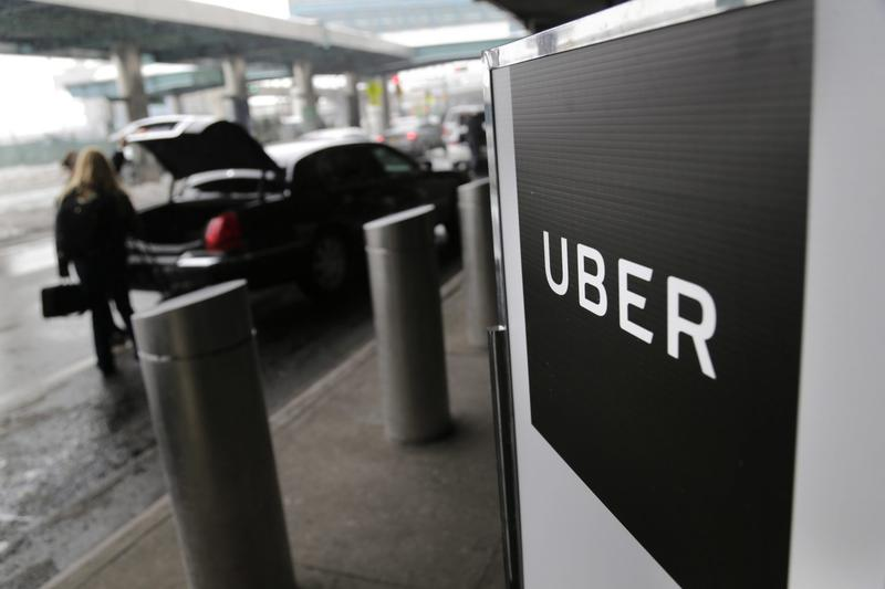 In this Wednesday, March 15, 2017 file photo, a sign marks a pick-up point for the Uber car service at LaGuardia Airport in New York. Jeff Jones, president of the embattled ride-hailing company Uber, has resigned just six months after taking the job, the company confirmed Sunday, March 19. (Seth Wenig, File/AP)