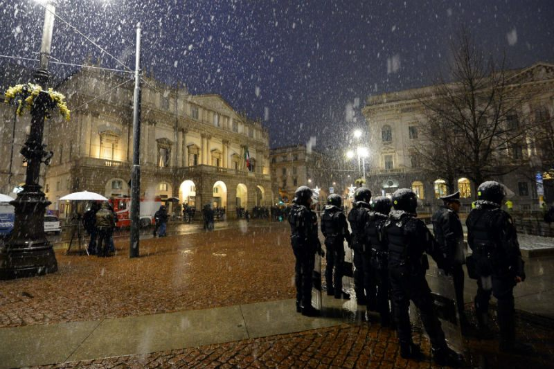 Riot policemen stand as guests arrive for the opening show of La Scala's season on Dec. 7, 2012