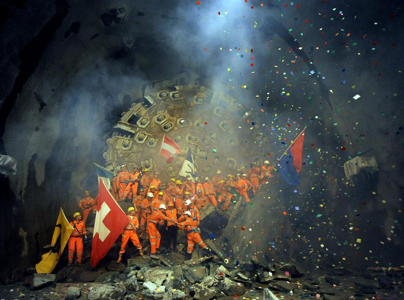 Workers celebrate the breakthrough of the second shaft of Gotthard Tunnel in Sedrun, Switzerland, on October 15, 2010.
