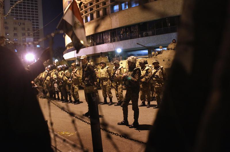 Egyptian army soldiers guard the national television building after Egyptian President Hosni Mubarak's February 10th speech to the nation, in the early hours of February 11, 2011 in Cairo, Egypt.