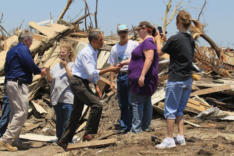 President Barack Obama greets people as he pays a visit to the community that was devastated a week ago by a tornado on May 29, 2011 in Joplin, Missouri.