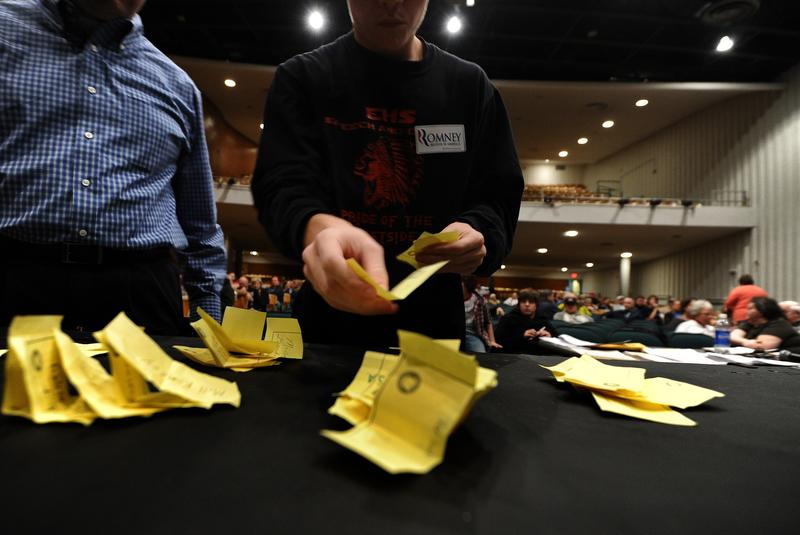 Electoral official count ballots during republican caucues at a school in Des Moines, Iowa, on January 3, 2012.