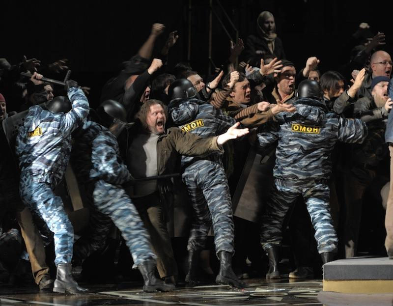Actors, some of them wearing uniforms of present-day Russia's riot police, in a new production of 'Boris Godunov' at the Mariinsky Theatre