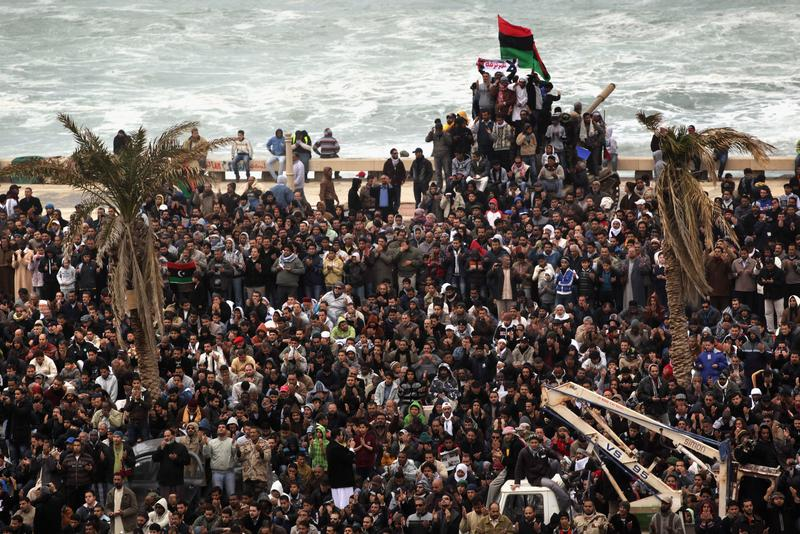 Libyans pray while demonstrating for the removal of Libyan leader Muommar Gadhafi on February 25, 2011 in Benghazi, Libya.