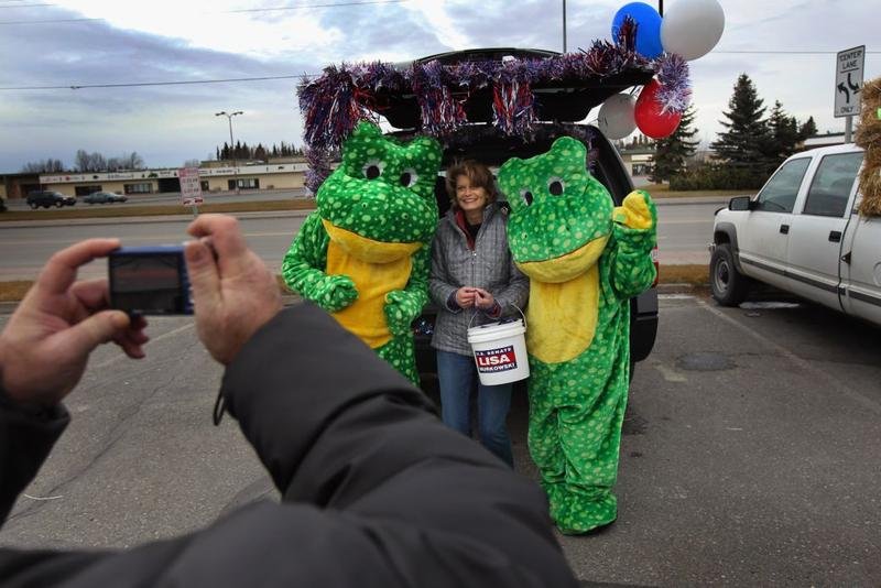U.S. Sen. Lisa Murkowski (R-AK) (C) poses for photos at a Halloween campaign event on October 31, 2010 in Kenai, Alaska.