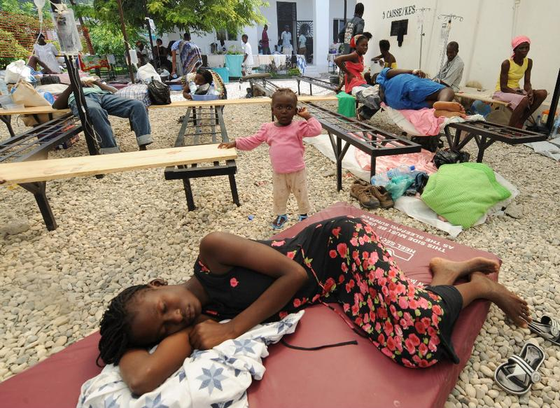 Sick victims and families wait for treatment at St. Nicolas Hospital in St. Marc, north of Port-au-Prince.