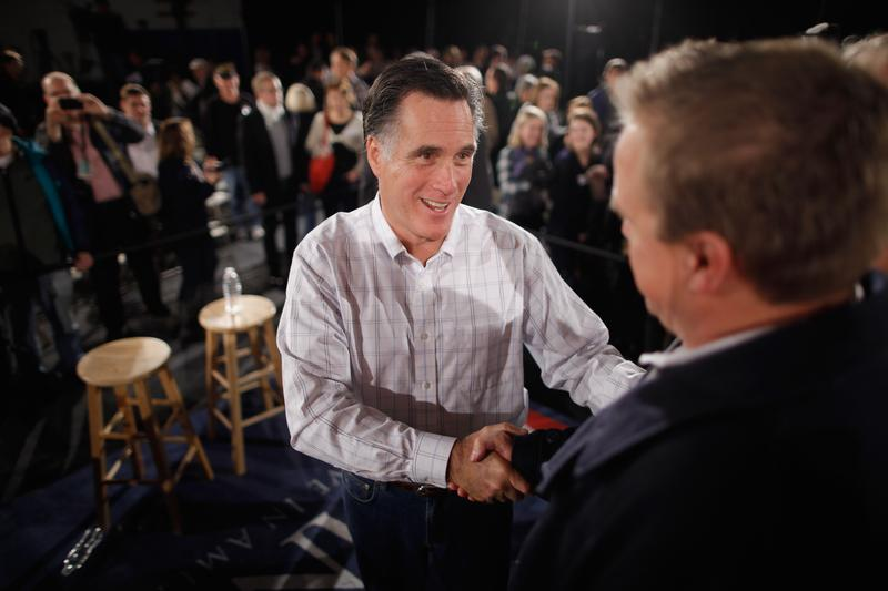 Republican presidential candidate, former Massachusetts Governor Mitt Romney greets supporters during a campaign town hall meeting at the Boys and Girls Club January 5, 2012 in Salem, New Hampshire.