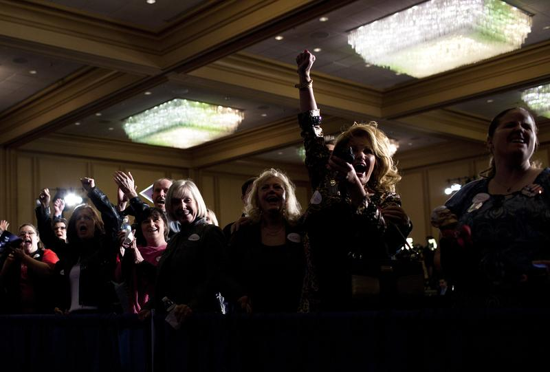 Gingrich supporters cheer when he's declared the winner of the Georgia GOP primary.