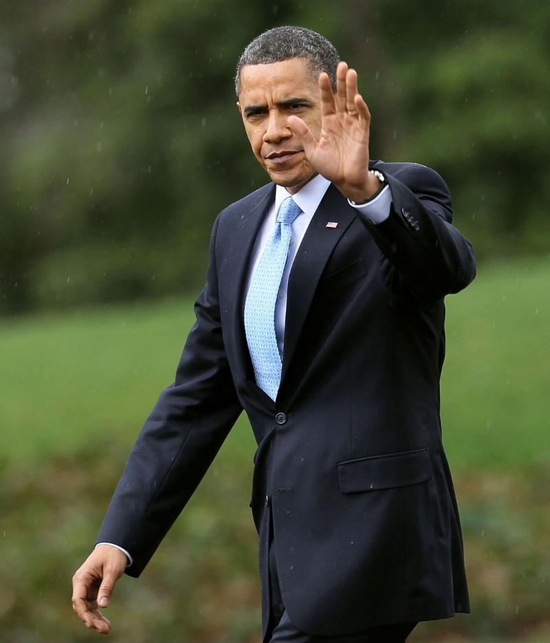 U.S. President Barack Obama waves as he walks towards Marine One while departing the White House for Strongsville, Ohio, where he is scheduled to speak about health care legislation.