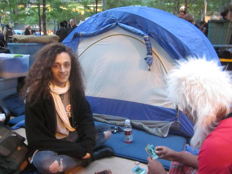 Dre DiMura near one of the many tents that have sprouted up at Zucotti Park in recent days