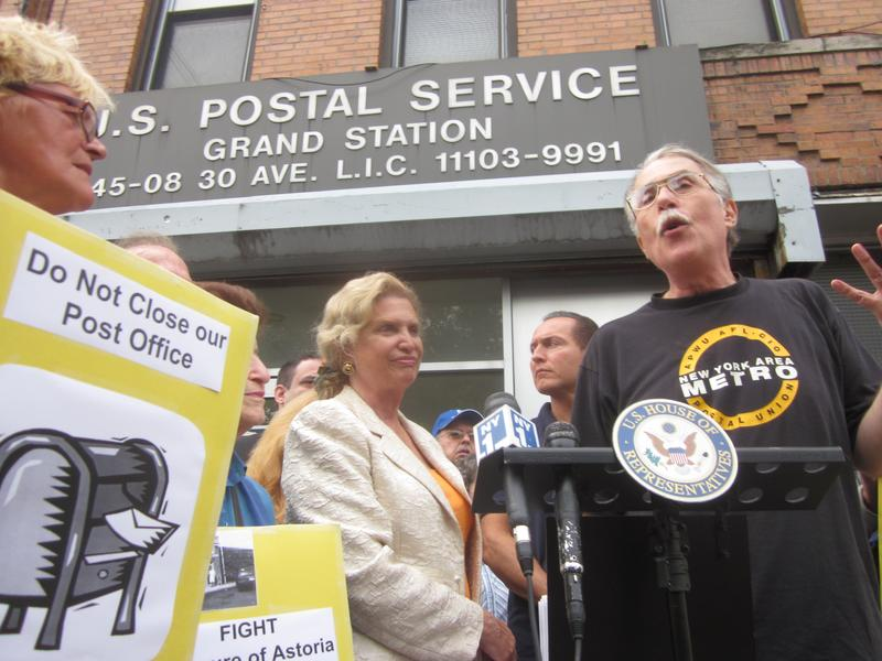 Rep. Carolyn Maloney (center), with a postal employee in Astoria