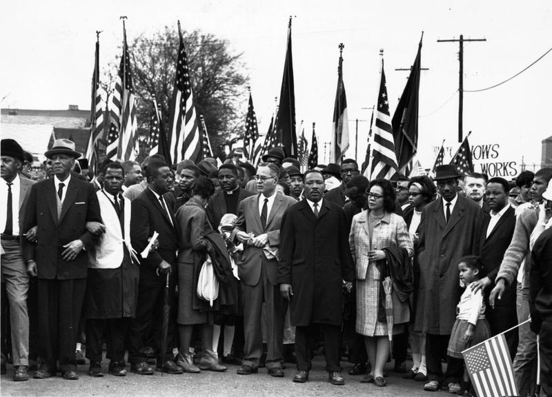 Civil rights campaigner Dr. Martin Luther King (1929 - 1968) with his wife Coretta Scott King, at the voting rights march from Selma, Alabama, to the state capital in Montgomery.