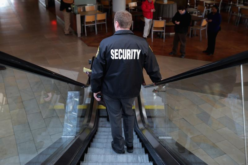 security guards prepare for the mall in columbia to reopen two days after three people were shot and killed at the shopping mall january 27