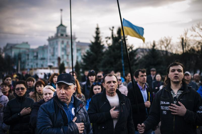 People sing the Ukrainian national anthem during a pro-Ukraine rally on April 15, 2014.