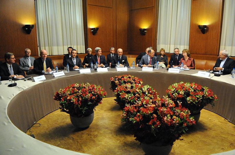 U.S. Secretary of State John Kerry sits with his fellow P5+1 foreign ministers at the UN headquarters in Geneva, after the group concluded negotiations about Iran's nuclear program. Nov 24, 2013