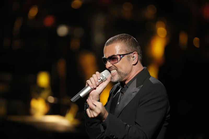 British singer George Michael performs at a concert to raise money for AIDS charity Sidaction in Paris, France, 2012.