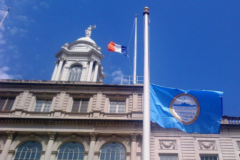 City Hall is flying the city flag (left) and the Boston flag to show solidarity following the twin bombings in the city.