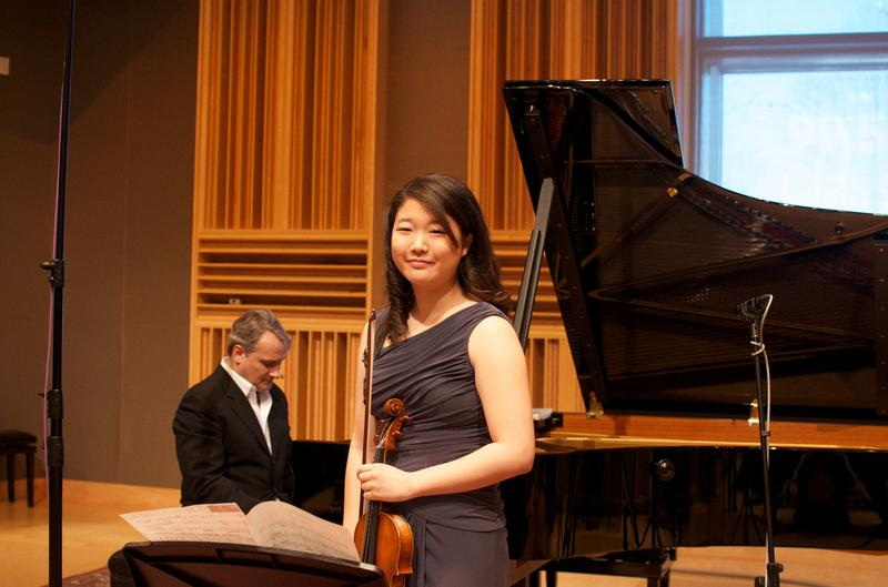 Violinist Chelsea Kim accompanied by host and pianist Christopher O'Riley.