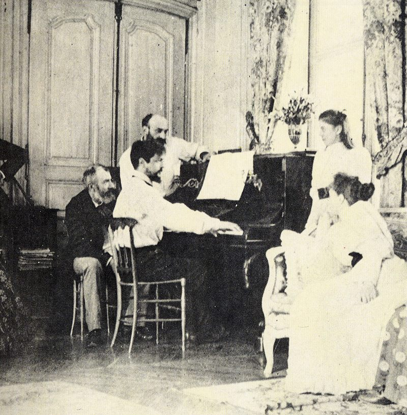 Debussy at the piano in front of the composer Ernest Chausson, 1893