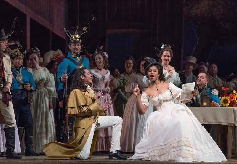 "Ildebrando D'Arcangelo as Dulcamara and Pretty Yende as Adina in Donizetti's ""L'Elisir d'Amore."""