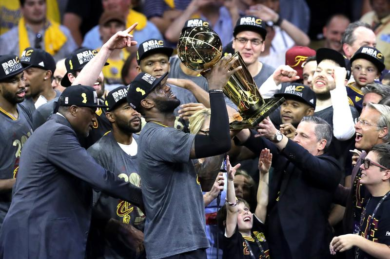 ef313e01b LeBron James of the Cleveland Cavaliers holds the Larry O Brien  Championship Trophy after defeating the Golden State Warriors 93-89 in Game  7 of the 2016 ...
