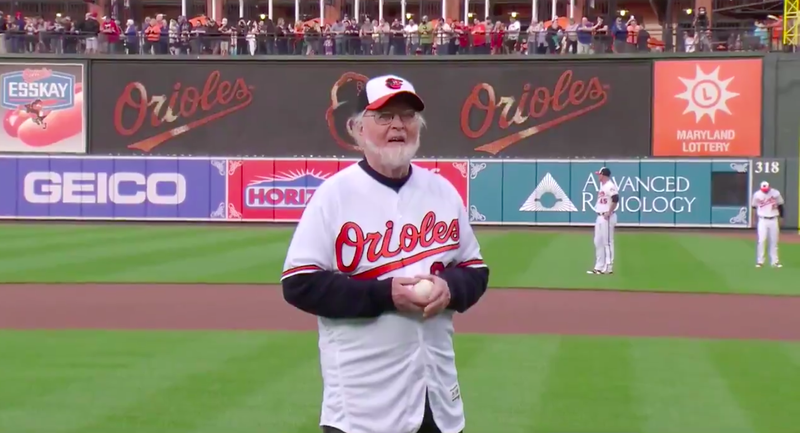 Composer John Williams threw out the first pitch for the Baltimore Orioles before a game against the Boston Red Sox.
