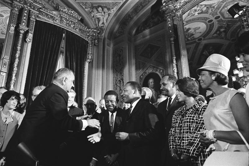 President Lyndon Johnson meets with Martin Luther King, Jr. after signing the Voting Rights Act.