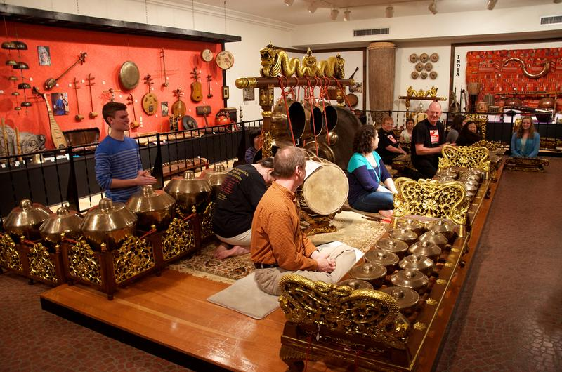Performers try a selection of instruments from Indonesia on display at the National Music Museum in South Dakota.
