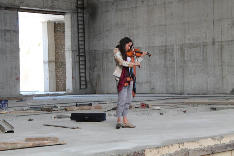 Violinist Noemi Gasparini on the nearly-constructed stage of the Palcco in Guadalajara, Mexico