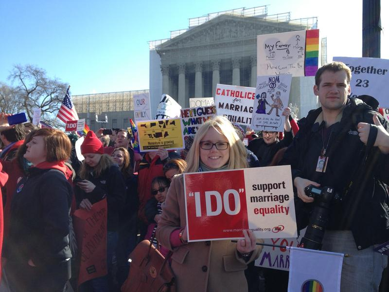 A gay marriage supporter in front of the Supreme Court during DOMA oral arguments.