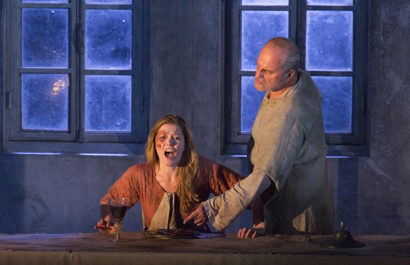 Barbara Hannigan and Christopher Purves dine together in George Benjamin's 'Written on Skin'