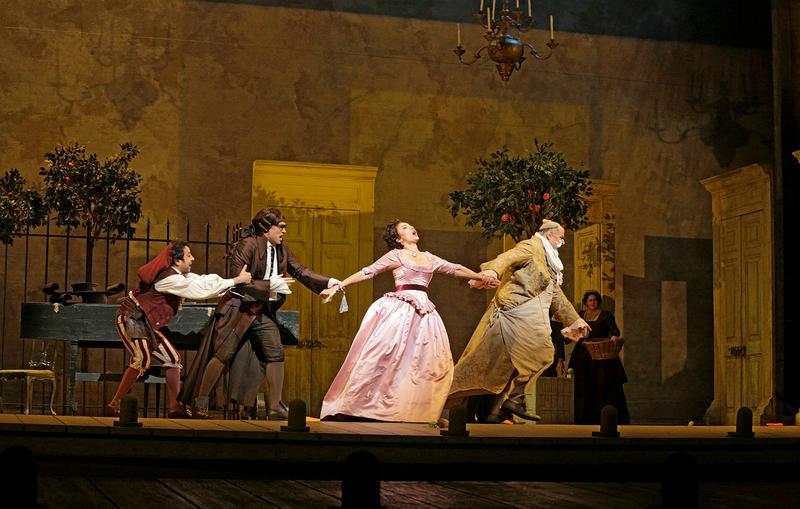 """A scene from Rossini's """"Il Barbiere di Siviglia,"""" with Isabel Leonard (center) as Rosina."""