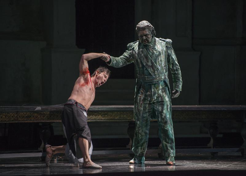 "Mariusz Kwiecień in the title role and Andrea Silvestrelli as the Commendatore in Mozart's ""Don Giovanni"""