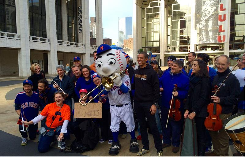 Mr. Met poses with Metropolitan Opera Musicians and Staff at Lincoln Center
