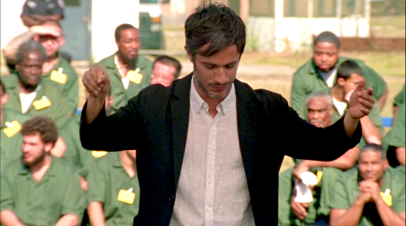 Rodrigo (Gael García Bernal) conducts in front of inmates at Rikers Island