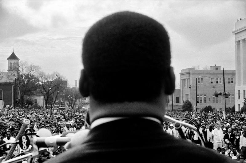 Dr. Martin Luther King, Jr., speaking in front of 25,000 civil rights marchers, at the conclusion of the Selma to Montgomery march.