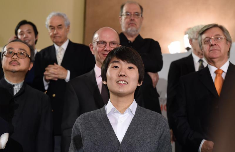 South Korean pianist Seong-Jin Cho, winner of 17th International Chopin Piano Competition stands with members of the jury