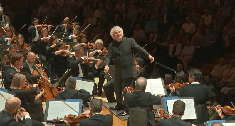 From memory, Simon Rattle conducts the London Symphony Orchestra during a performance of Mahler's Tenth Symphony.