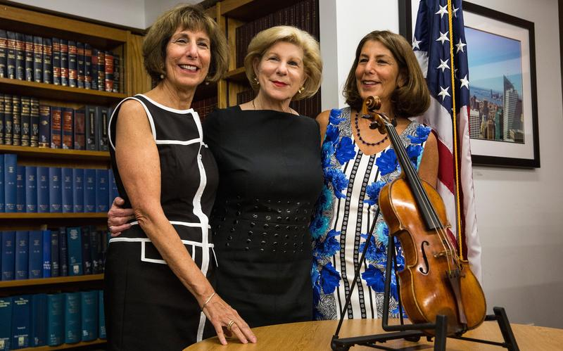 (L-R) Jill Totenberg, Nina Totenberg and Amy Totenberg view their father's Stadivarius violin, which was stolen 35 years ago, at an FBI press conference.