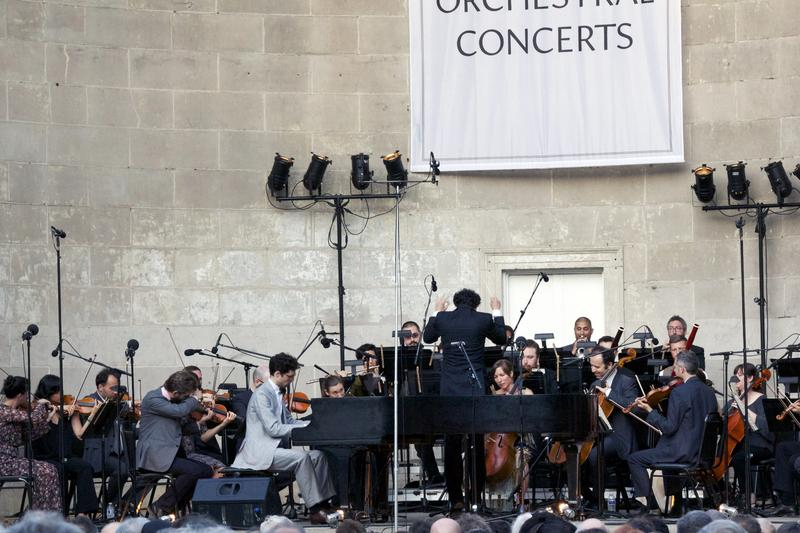 """The Knights with soloist Timo Andres perform a reworking of Mozart's Piano Concerto No. 26 """"Coronation"""" at the Naumburg Bandshell in Central Park."""