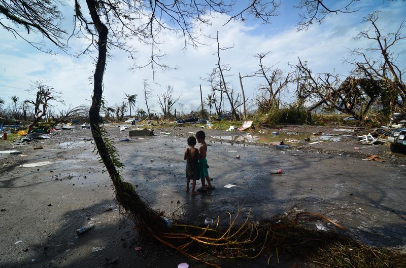 Two young boys look at the devastation in the aftermath of typhoon Haiyan on November 10, 2013 in Tacloban City, Leyte, Philippines. Typhoon Haiyan, packing maximum sustained winds of 195 mph.