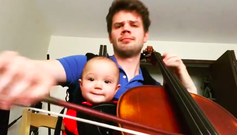 Cellist Warren Oja with his infant daughter.