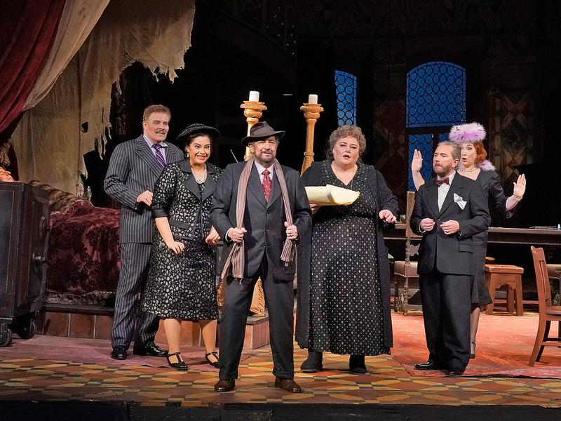 "Plácido Domingo (center) in the title role of Puccini's ""Gianni Schicchi""  with Jeff Mattsey as Marco, Gabriella Reyes as Nella, Stephanie Blythe as Zita, Tony Stevenson as Gherardo, and Lindsay Amman"
