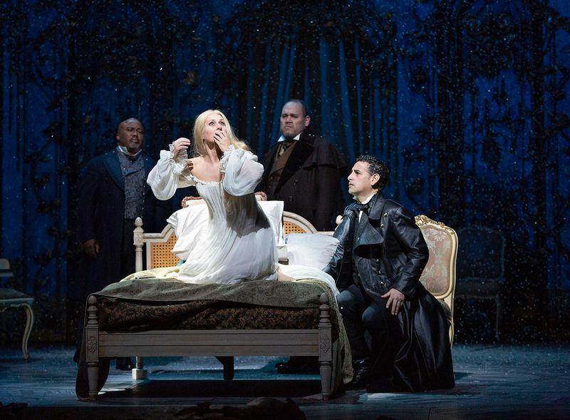 "Kevin Short as Dr. Grenvil, Diana Damrau as Violetta, Quinn Kelsey as Giorgio Germont, and Juan Diego Flórez as Alfredo in Verdi's ""La Traviata."""