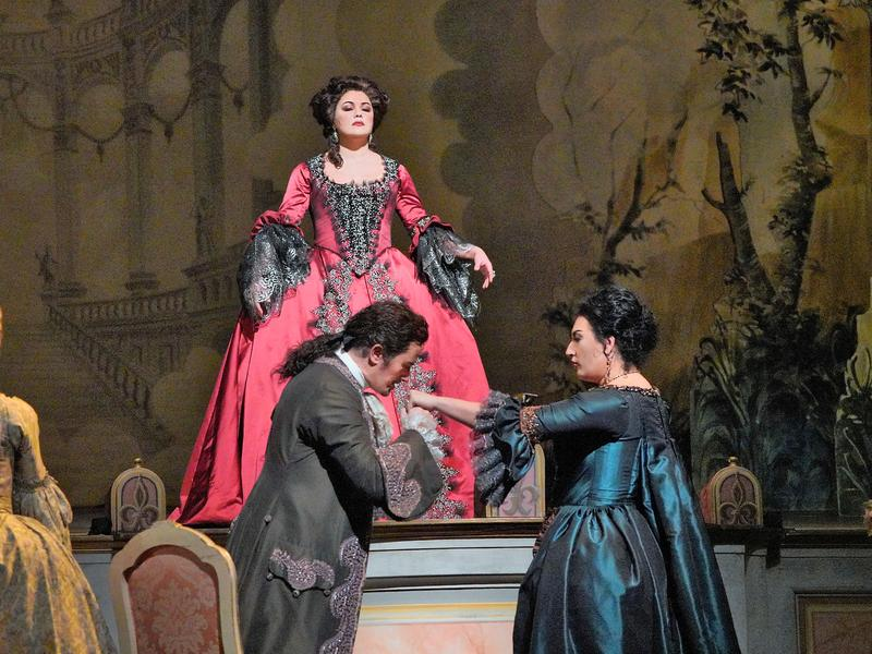 "Anna Netrebko as Adriana, Piotr Beczała as Maurizio, and Anita Rachvelishvili as the Princess of Bouillon in Cilea's ""Adriana Lecouvreur."""