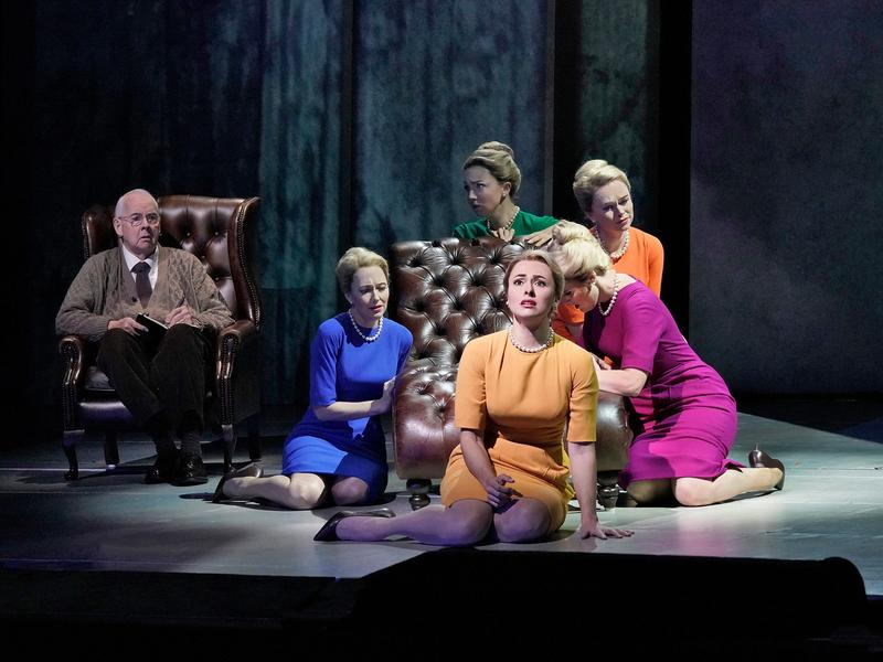 "James Courtney as Dr. Roman and Isabel Leonard (foreground) in the title role of Nico Muhly's ""Marnie"" with Dísella Lárusdóttir (in blue), Peabody Southwell (green), Deanna Breiwick, (orange) and Reb"