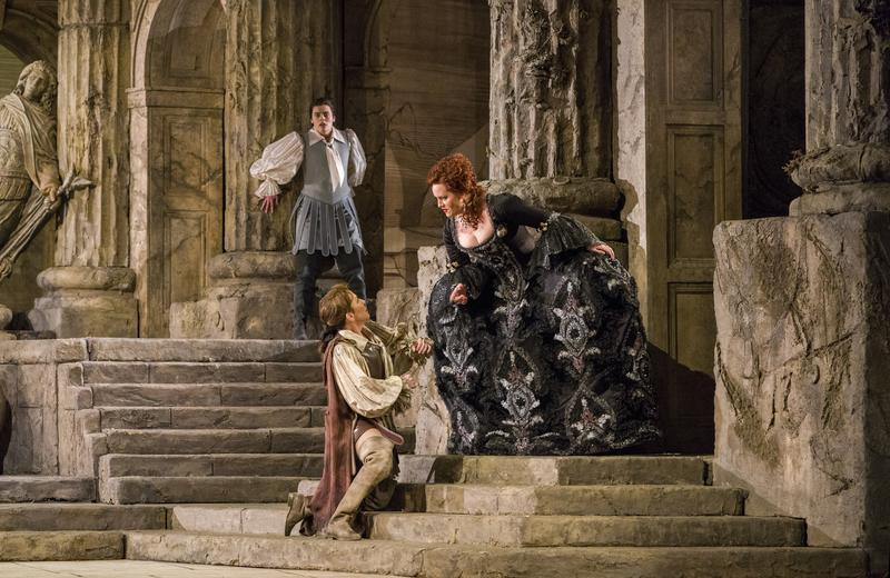 "Emily D'Angelo (background) as Annio, Joyce DiDonato (kneeling) as Sesto, and Elza van den Heever as Vitellia in Mozart's ""La Clemenza di Tito."""