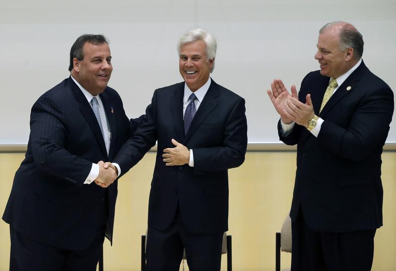 Gov. Chris Christie, George Norcross, and State Senate President Steve Sweeney at a groundbreaking ceremony in 2014, in Camden for a Norcross-funded school.